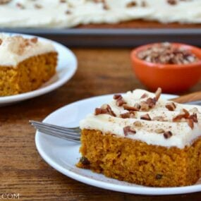 A slice of the best Pumpkin Bars with Cream Cheese Frosting on a white plate