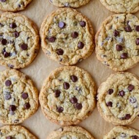 Top down view of Blended Oatmeal Chocolate Chip Cookies on parchment paper