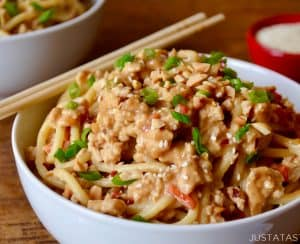 Dan Dan Noodles with Chicken in white bowl with chopsticks