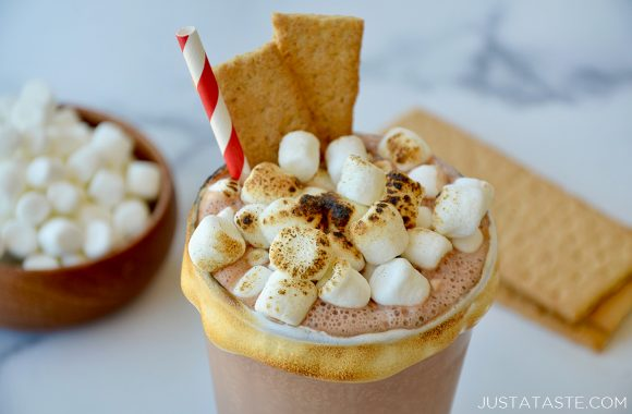 Easy s'mores milkshakes garnished with toasted mini marshmallows and graham crackers