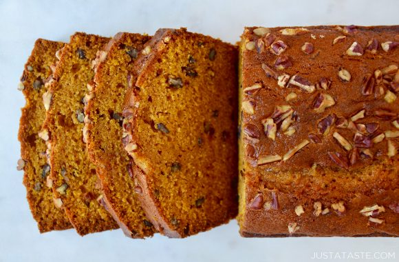The Best Pumpkin Bread topped with pecans and sliced