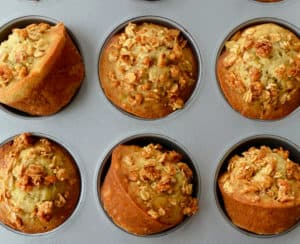 Muffin pan containing freshly baked Banana Granola Muffins