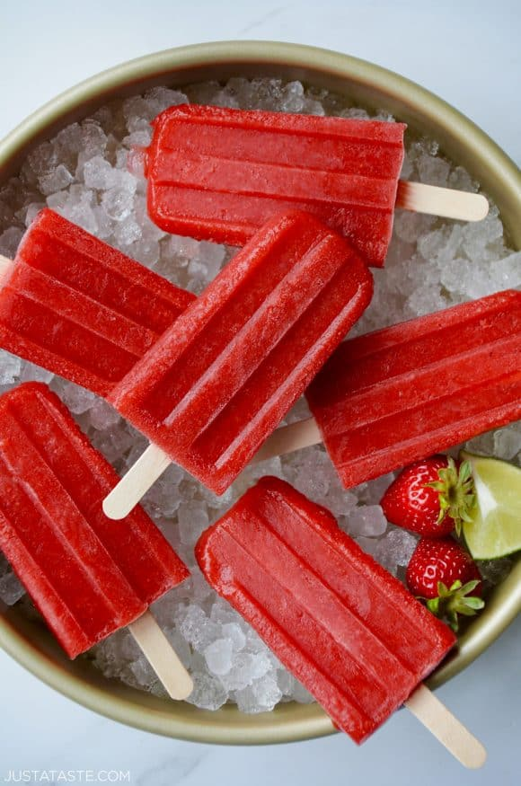 Top down view of Strawberry Margarita Popsicles on ice