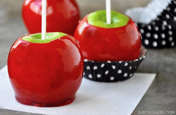 Candy apples in cupcake wrappers on a baking sheet