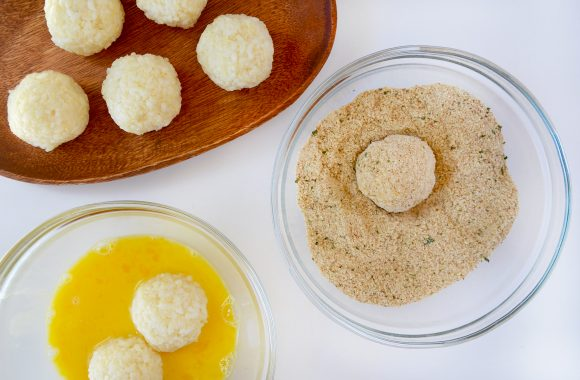 Arancini dipped in eggs and breadcrumbs