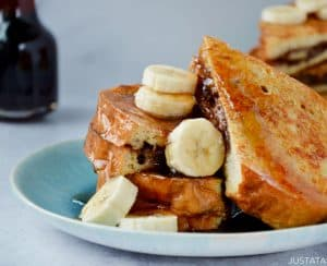 Easy Banana and Nutella Stuffed French Toast topped with banana slices