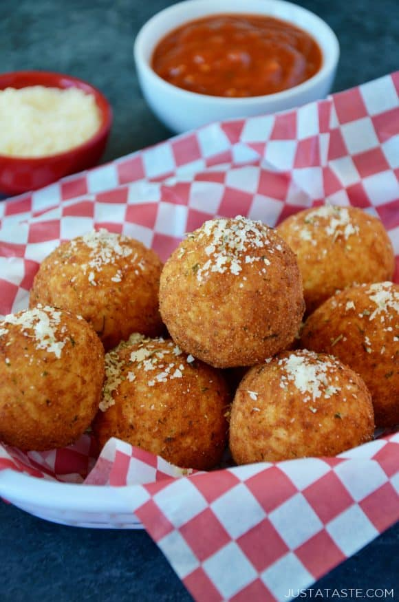 The best arancini rice balls in a basket sprinkled with parmesan cheese