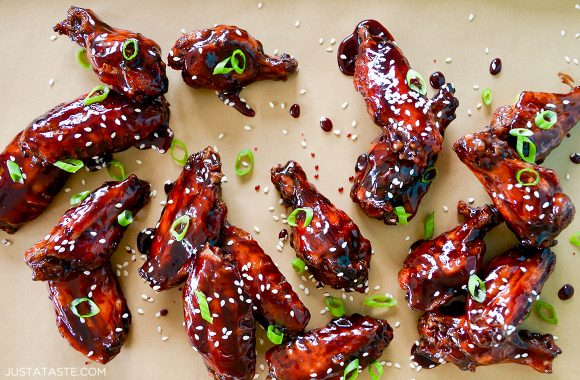The best baked asian chicken wings garnished with sesame seeds and sliced scallions