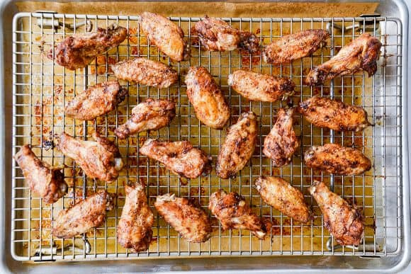 Cooling rack with wings over parchment paper-lined baking sheet