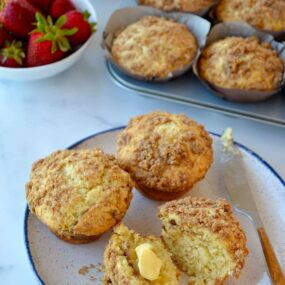 The best Sour Cream Coffee Cake Muffins with Streusel slathered with butter