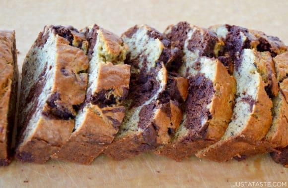 Sliced Chocolate Swirl Banana Bread on wood cutting board