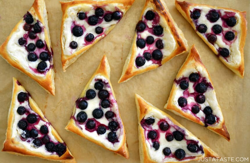 Top-down view of Cream Cheese Pastries topped with juicy blueberries