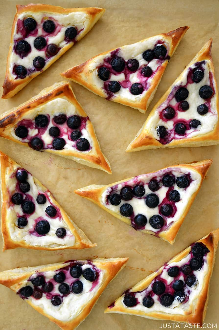 Top-down view of Blueberry Cream Cheese Pastries on brown parchment paper.