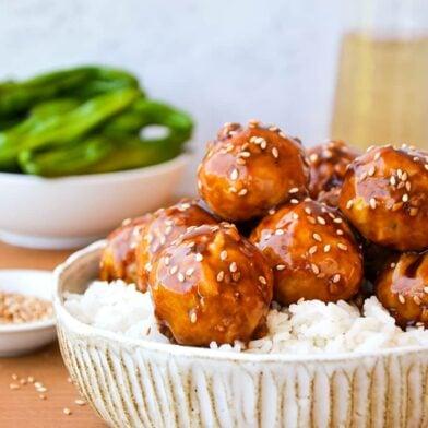 Baked Teriyaki Chicken Meatballs over white rice in large bowl