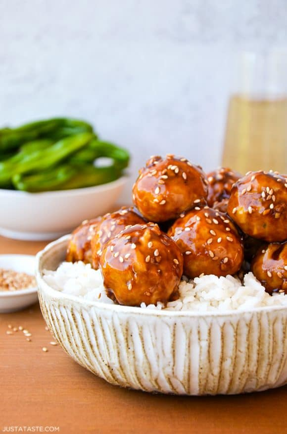 Baked Teriyaki Chicken Meatballs over white rice in large bowl