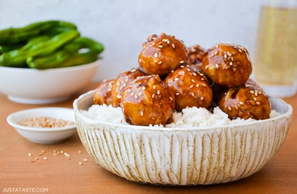 Extra-moist baked teriyaki chicken meatballs over rice in a bowl