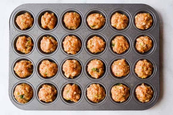 Mini muffin tin with meatballs
