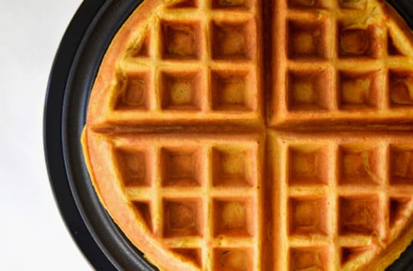 Cooked pumpkin spice waffle in waffle maker