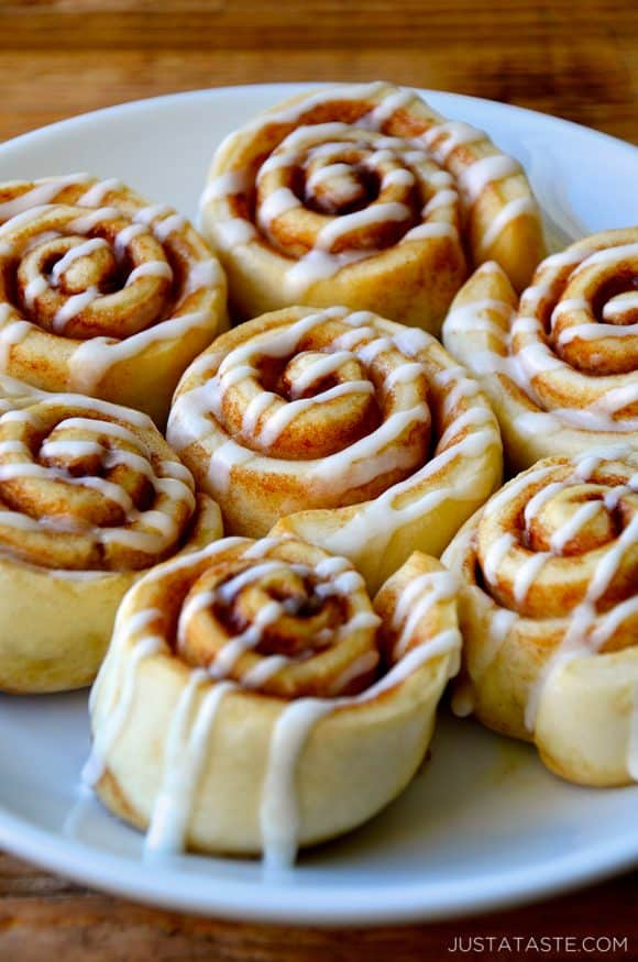 Pizza Dough Cinnamon Rolls with glaze on serving plate
