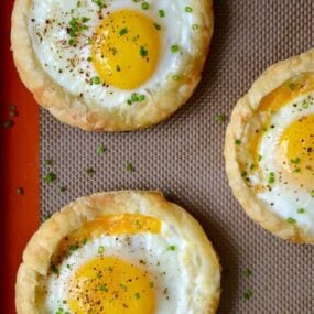 Cheesy Puff Pastry Baked Eggs recipe from justataste.com