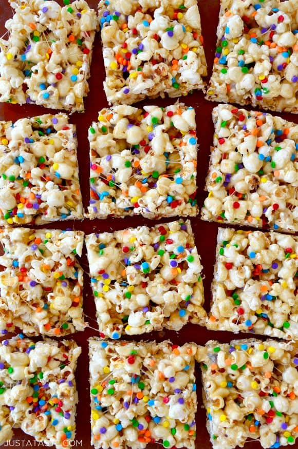 Squares of Funfetti Popcorn Treats made with marshmallows