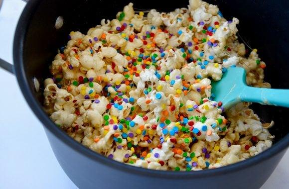Large stock pot with spatula stirring marshmallow treats