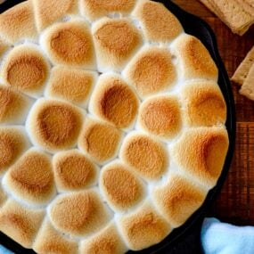 A cast-iron skillet containing toasted marshmallows