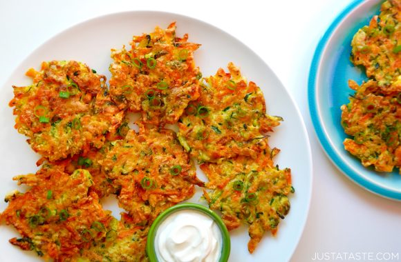 Quick and Crispy Vegetable Fritters on a plate with sour cream