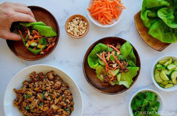 Spread of Chinese Chicken Lettuce Wraps and sliced veggies