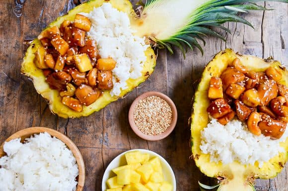 Sticky Pineapple Chicken in hollowed pineapples