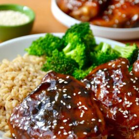 Chicken thighs coated in a honey-soy glaze served with rice and broccoli