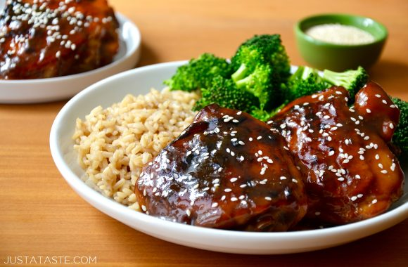 Glazed Honey Soy Chicken Thighs on a plate with brown rice and broccoli