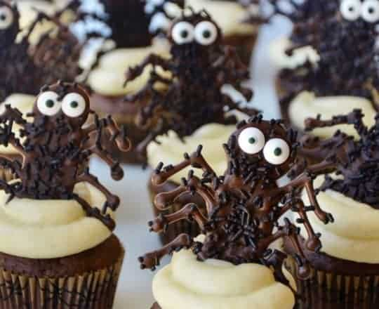 Chocolate Halloween Cupcakes topped with cream cheese frosting and chocolate spiders