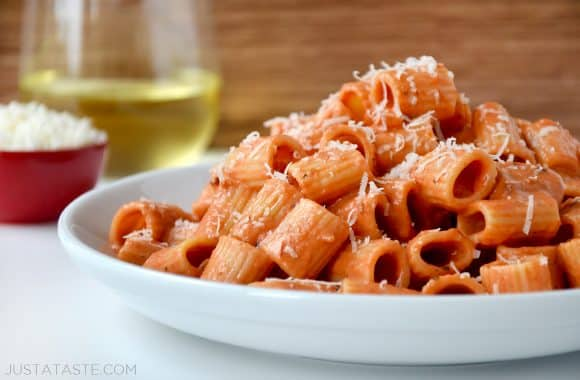 Vodka pasta on a white plate with Parmesan cheese