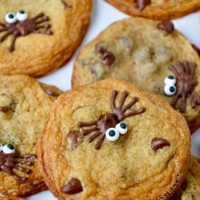 A close-up of Spider Chocolate Chip Cookies stacked on top of each other