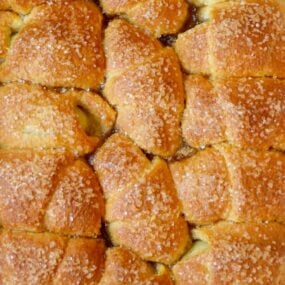 A pan of Crescent Roll Apple Dumplings studded with sanding sugar