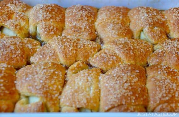 A baking dish close-up of Crescent Roll Apple Dumplings