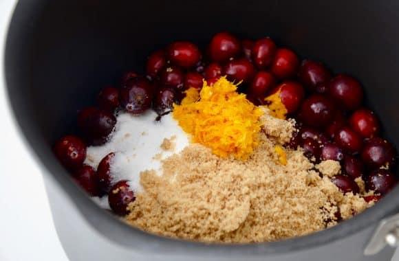 Orange zest, fresh cranberries and brown sugar in a saucepan