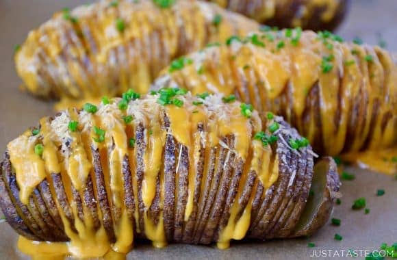 Hasselback potatoes filled with cheese and topped with chives