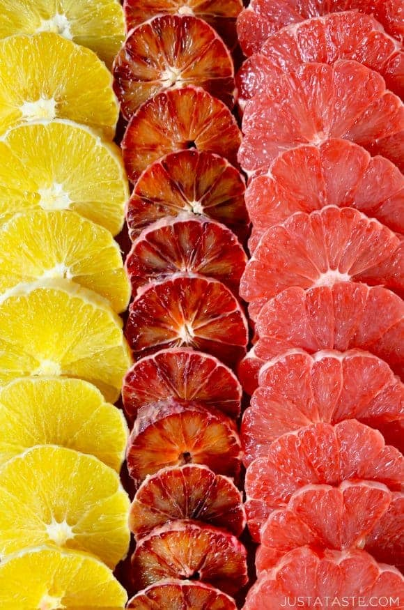 A close-up of sliced oranges, blood oranges and grapefruits