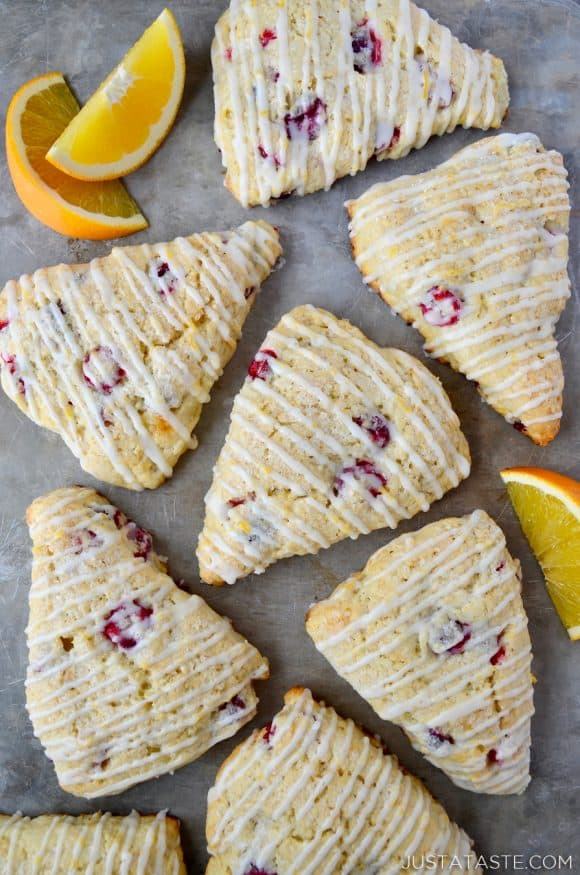 Glazed Orange Cranberry Scones with orange slices on gray background