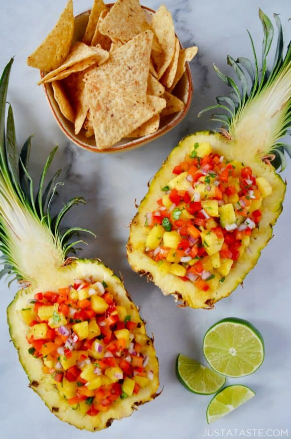 The best pineapple salsa just a taste two pineapple boats filled with the best pineapple salsa with a cut lime and small bowl forumfinder Gallery