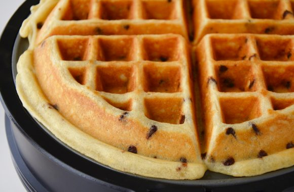 Cooked buttermilk chocolate chip waffle in waffle maker.