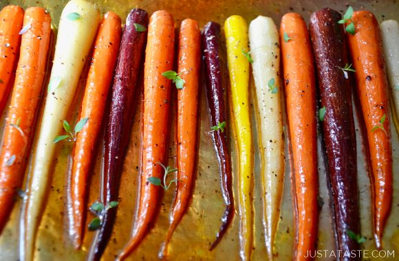 Multi-colored Easy Honey Roasted Carrots on aluminum foil.