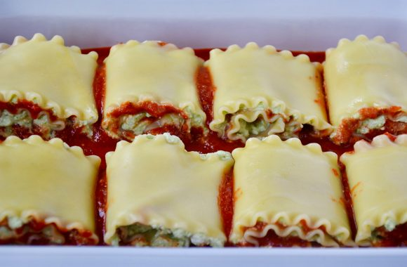 Easy lasagna roll-ups in white baking dish