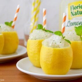 White plates with hollowed out lemons filled with Easy Lemon Granita