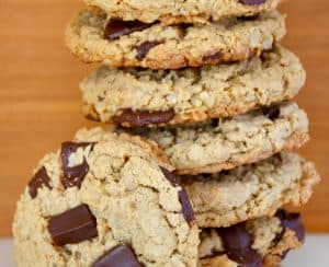 Stack of Flourless Oatmeal Chocolate Chip Cookies with one cookie on its side leaning against the stack.