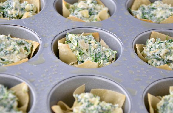 Spinach-Artichoke Dip Wonton Cups in greased muffin tin.
