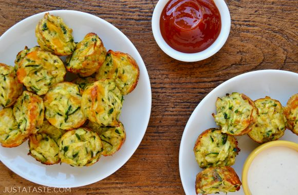 Cheesy Baked Zucchini Tots on white serving plates with ketchup and Ranch dressing