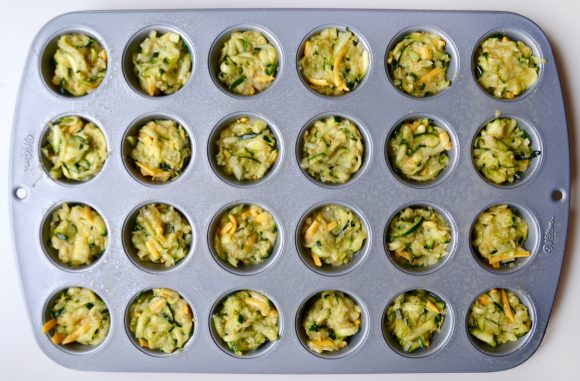 Cheesy zucchini tots in mini muffin pan